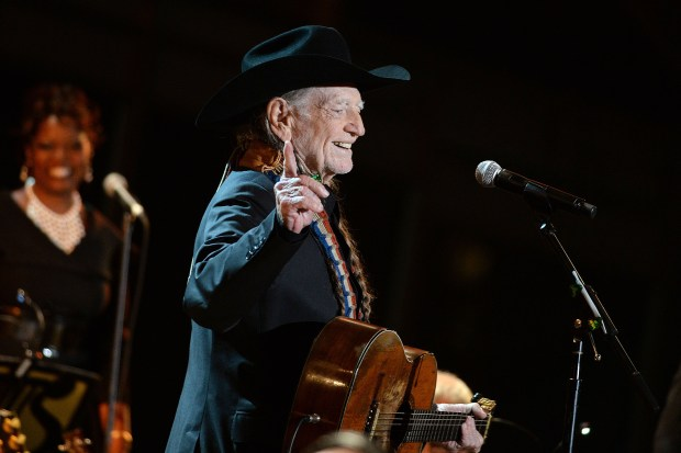 """WASHINGTON, DC - NOVEMBER 06: (AFP OUT) Singer Willie Nelson performs at """"A Salute to the Troops: In Performance at the White House"""" on the South Lawn November 6, 2014 in Washington, DC. The President and First Lady invited music legends, members of the U.S. military, military veterans, and their families to the White House for a celebration of the men and women who serve the United States. (Photo by Olivier Douliery-Pool/Getty Images)"""