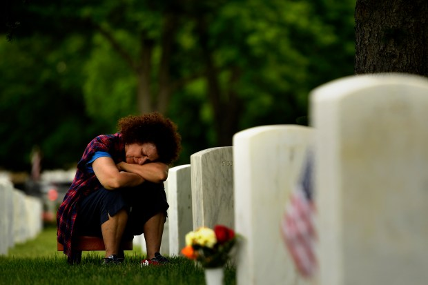 DENVER, CO - MAY 30: Andi Schorr grieves at the grave of her husband Sergeant First Class George Joseph Schorr. Schorr served two tours of duty in Viet Nam and died in 1979 of cancer. Memorial Day ceremony, 84th Anniversary of Remembrance at Fort Logan National Cemetery. May 30, 2016 in Denver, CO. (Photo By Joe Amon/The Denver Post)