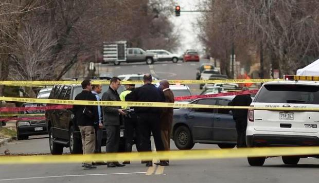 Denver police investigate an officer-involved shooting Monday near Lowell Boulevard and West 35th Avenue.