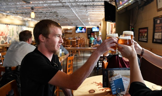BOULDER, CO - MAY 24: The Twisted Pine Brewing Company in Boulder is pulling back on it's sale of bottled beer to liquor stores and concentrating on it's tap room and restaurant at 3201 Walnut Street in Boulder. Tim Gannon toasts friends on a round of beers on Tuesday, May 24, 2016. (Photo by Cyrus McCrimmon/The Denver Post)