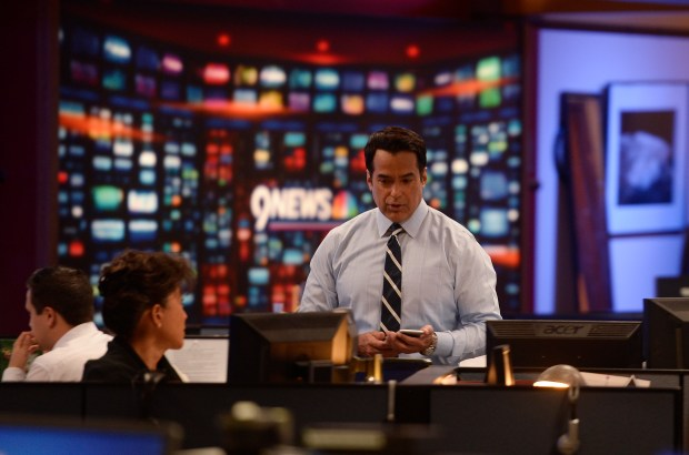 DENVER, CO - MAY 17: Vicente Arenas is a new weekend anchor and reporter at 9News. He was working on a story on the University of Colorado A-Line Train to DIA in the newsroom at the Denver station KUSA on Tuesday, May 17, 2016. (Photo by Cyrus McCrimmon/The Denver Post )