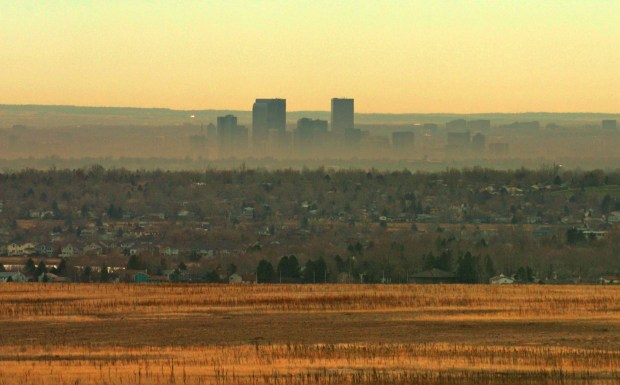 A brown cloud surrounds the Denver skyline.