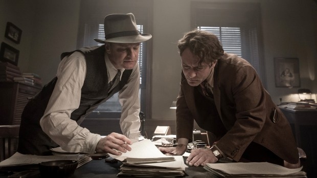 """Literary editor Maxwell Perkins (Colin Firth) and author Thomas Wolfe (Jude Law) look over Wolfe's writing in """"Genius."""""""