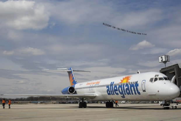 FILE - In this Wednesday, April 13, 2016 file photo, a small plane with a banner flies over Flint Bishop Airport to celebrate the ribbon cutting for Allegiant Air joining Flint Bishop International Airport in Flint, Mich. Discount airline Allegiant Air is set to land at Newark Liberty International Airport. Allegiant has been given final approval to begin offering service at the airport in November. Tickets can be purchased beginning Tuesday, June 28, some for as low as $39 one-way. (Conor Ralph/The Flint Journal- MLive.com via AP, File) MANDATORY CREDIT