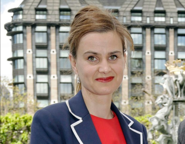 RECROP OF LON812 FILE  In this May 12, 2015 file photo, Labour Member of Parliament Jo Cox poses for a photograph. British lawmaker Cox has been injured in a shooting incident near Leeds, in West Yorkshire, England, it has been reported, Thursday June 16, 2016. (Yui Mok/PA via AP, File) UNITED KINGDOM OUT NO SALES NO ARCHIVE
