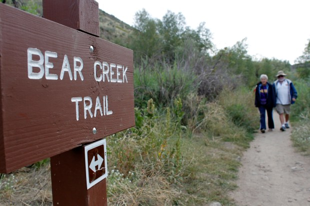 Susan Schnick, left, and Bill Kirby head down the Bear Creek Trail as they join a group of retirees on a fit hike in Jefferson County, Colo., near the tiny town of Idledale, Colo., on Monday, Sept. 13, 2010. The group of retirees from the Jefferson County, Colo., school district travel all over the Front Range to sample new trails each Monday. (Special to The Denver Post, David Zalubowski)