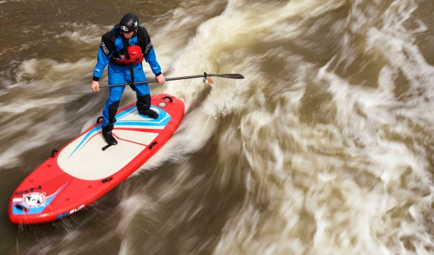 A stand-up boarder tackles the South Platte River.