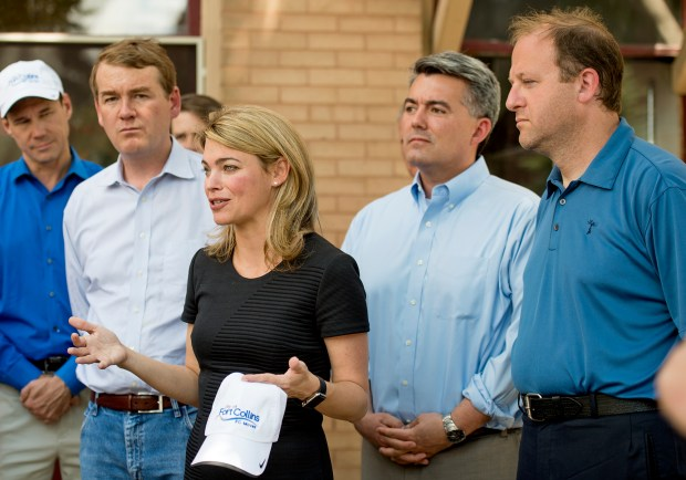 Sarah Feinberg, center, an administrator with the Federal Railroad Administration, addresses the media in Old Town Fort Collins on Friday afternoon June 17, 2016 after a walking tour of the Mason Corridor with city officials and area politicians including Senator Michael Bennet, left, Senator Cory Gardner, center right, and Congressman Jared Polis, far right.