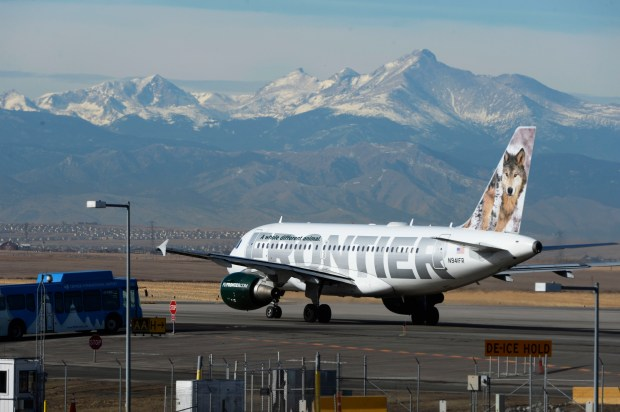 DENVER, CO - JANUARY 16: A Frontier airplane taxis to a runway on the west side of Denver International Airport January 16, 2015. Frontier Airlines announced Friday that it is outsourcing over 1300 reservations and airport operations jobs in Denver and Milwaukee. (Photo by Andy Cross/The Denver Post)