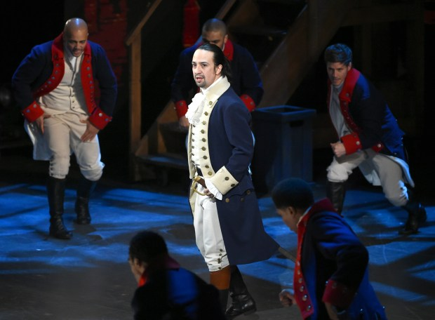"FILE - In this June 12, 2016 file photo, Lin-Manuel Miranda and the cast of ""Hamilton"" perform at the Tony Awards in New York. ""Hamilton"" took home 11 Tony Awards. Miranda said Thursday, June 16, 2016, that he is leaving his show this summer. Miranda said Thursday his last performance will be July 9. (Photo by Evan Agostini/Invision/AP, File)"