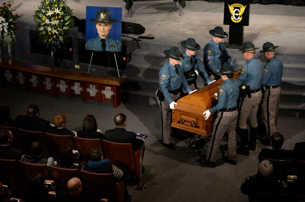 Members of the Colorado State Patrol attend to the casket at the end of the service during the recessional. Members of law enforcement from across the state and the country attend services for Colorado State Trooper Jaimie Lynn Jursevics at the Denver First Church of the Nazarene who was killed on Nov. 15, 2015.