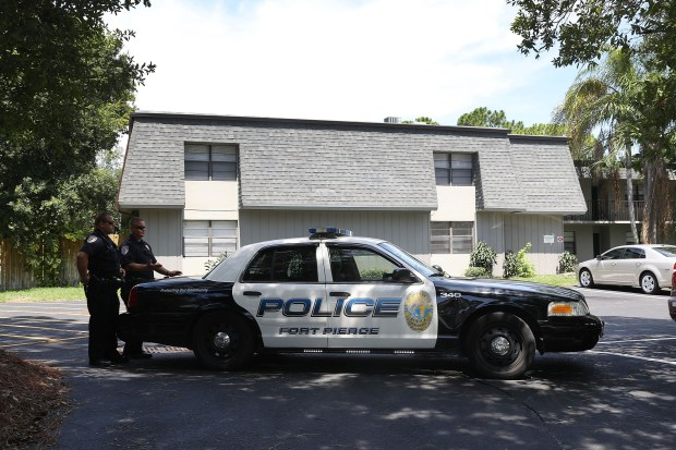 FORT PIERCE, FL - JUNE 12:  Police block the entrance to the apartment building where shooting suspect Omar Mateen is believed to have lived on June 12, 2016 in Fort Pierce, Florida. The mass shooting at Pulse nightclub in Orlando, Florida killed at least 50 people and injured 53 others in what is the deadliest mass shooting in the country's history.  (Photo by Joe Raedle/Getty Images)