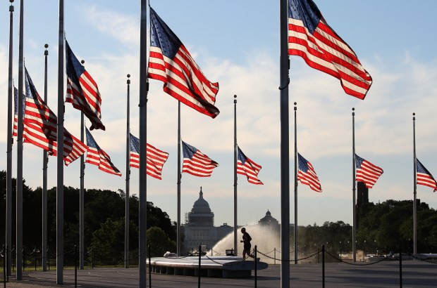 Flags are at half-staff Monday on the Washington Monument grounds to honor those killed by a lone gunman at a nightclub in Orlando, Fla. President Barack Obama ordered flags to be lowered on all government buildings.