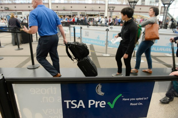 DENVER, CO - MAY 20: The TSA Pre Check is growing in popularity as travelers are looking ways to improve their times getting through long security screening lines. At Denver International Airport in the main terminal travelers pass through a much shorter line because they have the Pre Check pass on Friday, May 20, 2016. (Photo by Cyrus McCrimmon/The Denver Post )