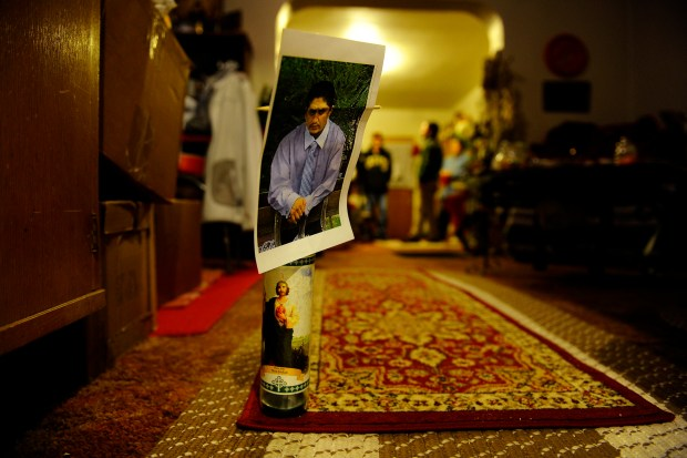 ROCKY FORD, CO. - December 16: Jack Jacquez, 27, was fatally shot in his mother's kitchen by a Rocky Ford police officer early one morning in October 2014. A candle and a photo mark the place where his head came to rest after he was shot. The officer, James Ashby, is the first Colorado officer to be charged with an on-duty murder in more than 20 years. (Photo By Mahala Gaylord/The Denver Post)