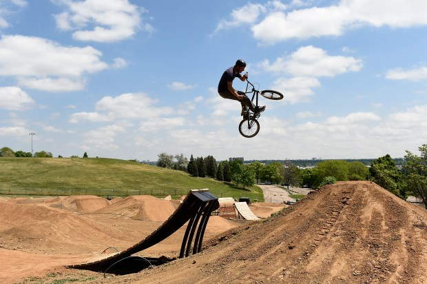 DENVER, CO - MAY 31: Ted Van Orman launches his bike off a ramp while doing a test run at the new Ruby Hill Bike Park in Denver, Colorado on May 31, 2016. Ruby Hill Bike Park is nearly complete after over a year of planning and work. (Photo by Seth McConnell/The Denver Post)