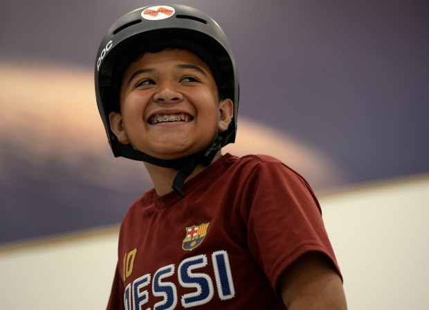 CENTENNIAL, CO - JUNE 20: Joshua Herrera, 11, breaks out in a big smile after a short time on a pair of skis. Instructors work with students at the new Snobahn Indoor Ski and Snowboard center in Centennial on Monday, June 20, 2016. The facility, located on the Streets at SouthGlenn shopping center, will host it's grand opening on Friday, June 24, 2016.(Photo by Kathryn Scott Osler/The Denver Post)