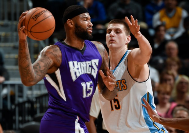 Sacramento Kings center DeMarcus Cousins (15) looks to pass as Denver Nuggets center Nikola Jokic (15) defends on the play, Feb. 23, 2016 at Pepsi Center.