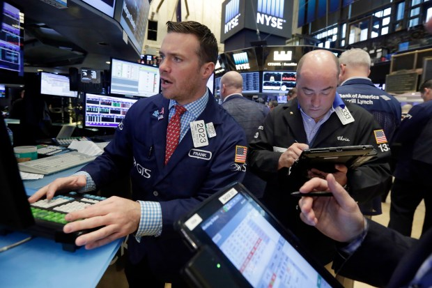 Specialist Frank Masiello, left, works on the floor of the New York Stock Exchange, Friday, June 17, 2016.