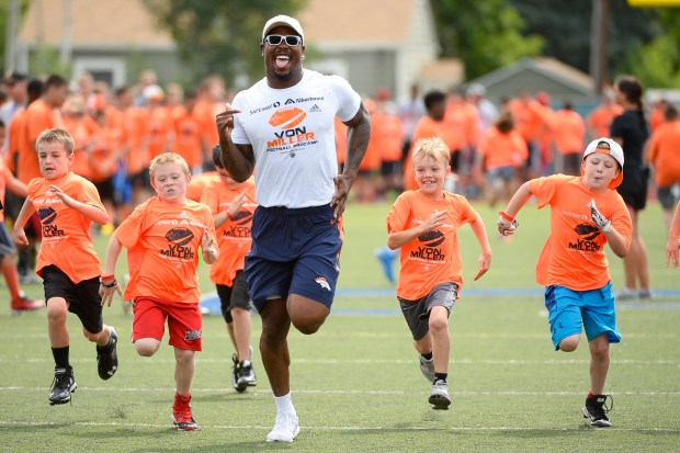 Von Miller races campers in a 40-yard dash Wednesday at his football camp at Englewood High School.
