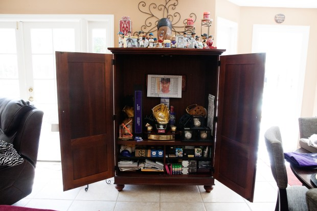 Lake Forest, CA - June 29, 2016: Colorado Rockies third baseman Nolan Arenado's Golden Glove Award and other memorabilia is pictured here in a cabinet at his parent's home on Wednesday. (Photo by Emily Berl/Special to The Denver Post)