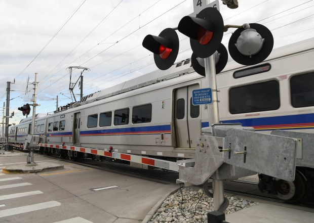 The new University of Colorado A-Line train crosses Holly Street along Smith Road on its way the airport, May 10, 2016. RTD has seen problems with the crossing signs in the area after the train to the airport opened.