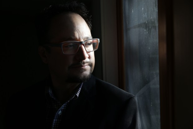 In this June 29, 2016 photo, Denver City Councilman Rafael Espinoza sits inside his home in Denver. Despite being one of the fastest growing economies in the nation, Denver's current success has accelerated gentrification, pushing many of Espinoza's former constituents far away against their wishes, and changing the demographics.
