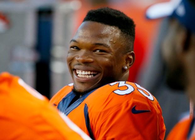 Denver Broncos running back Kapri Bibbs (35) smiles during the first half of an NFL preseason football game against the Arizona Cardinals, Thursday, Sept. 3, 2015, in Denver. (AP Photo/Jack Dempsey)