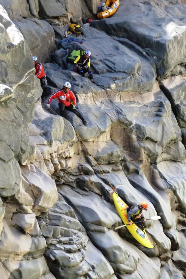 Members of the Polish Canoandes expedition lower Steamboat Springs kayaker and author Eugene Buchanan into the Cruz del Condor section of Peru's Colca Canyon, the deepest gorge in the world. Photo Special to The Denver Post by Grzegorz Gaj Grzesiek.