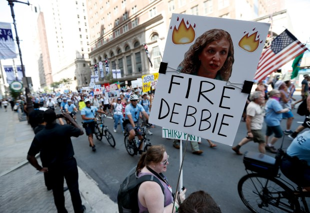 A supporter of Sen. Bernie Sanders holds up a sign on July 24 in Philadelphia calling for Debbie Wasserman Schultz, chairwoman of the Democratic National Committee, to be fired. Leaked e-mails showed that the DNC secretly sought to help Hillary Clinton beat Sanders win the Democratic presidential nomination.