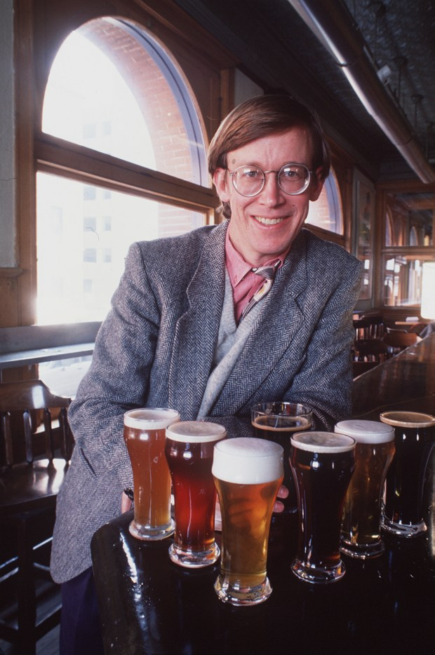 John Hickenlooper poses with some of the different brews from the Wynkoop Brewery in 1991.