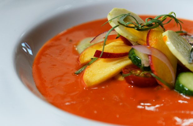DENVER, CO. - AUGUST 07: Chef Paul Reilly's chilled tomato soup with palisade peach, persian cucumber and tarragon at the Beast + Bottle restaurant August 07, 2014. (Photo By Andy Cross / The Denver Post)