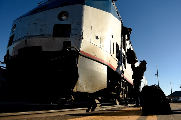 LA JUNTA, CO. - NOVEMBER 05: Engineer Lonnie Estep hands his bag up to student engineer Andrew Ornelas during a crew change on the Southwest Chief at La Junta, CO November 05, 2015 La Junta, CO (Photo by Joe Amon/The Denver Post)