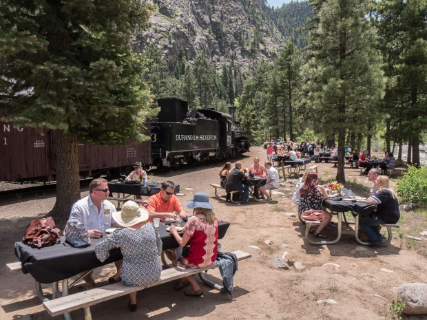 Durango Wine and Rails guests enjoy lunch at the Cascade Creek Wye, outside of Durango & Silverton Narrow Gauge Railroad.