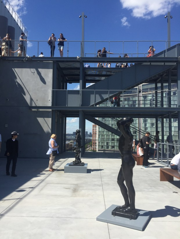 Visitors wander one of the sculpture decks at the Whitney Museum of American Art in New York's Meatpacking District, June 2016. (Photo by Jenn Fields, The Denver Post)