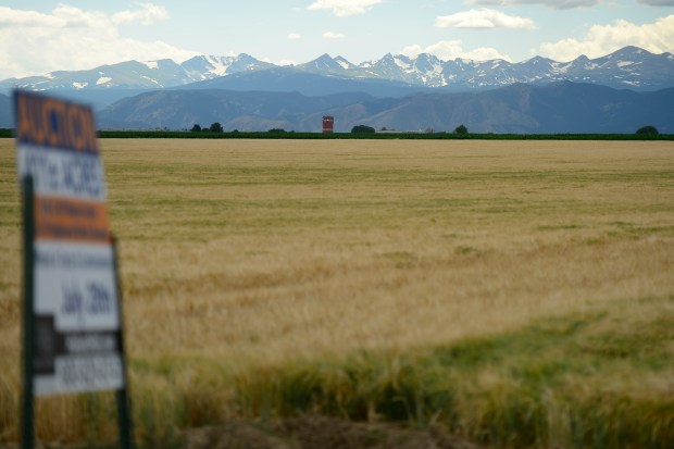 LONGMONT, CO - JULY 5: 411 acres in Longmont for sale by auction sit in the foreground of the mountains on July 5, 2016. (Photo by Michael Reaves/The Denver Post)