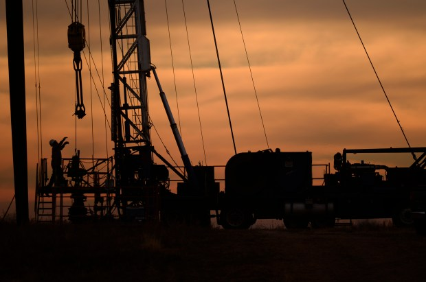 An oilfield worker starts his days' work before the sun rises in Kersey.