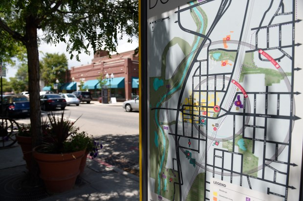A map of downtown is featured on one of the new way finding signs in Littleton, Colorado on July 19, 2016. The City of Littleton finally rolled out way finding signage last week across the Historic Downtown area. The signs, each of which is one of a kind with historical notes and directions to nearby business, were produced following a dispute between the city with downtown business owners over sidewalk displays. (Photo by Seth McConnell/The Denver Post)