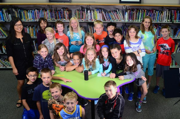 Denver Post technology reporter Tamara Chuang poses with the fifth grade computer class at Heritage Elementary School in Highlands Ranch. The kids spent their class period asking the new Amazon Tap's AI Alexa Voice Service questions, some in an attempt to help with homework and others tried to stump the machine on August 24, 2016.