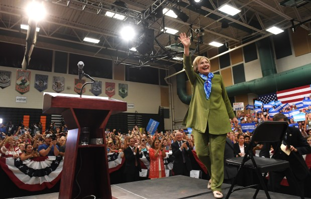 Democratic presidential nominee Hillary Clinton waves as she arrives to speak at Adams City High School in Commerce City on Aug. 3