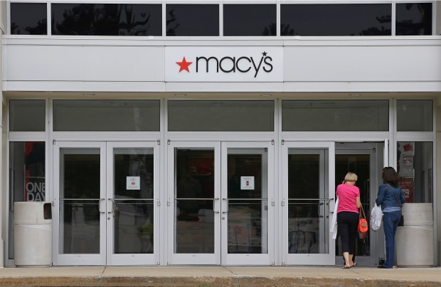 FILE - In this July 10, 2015, file photo, shoppers walk into a Macy's department store at the Hanover Mall in Hanover, Mass. Macy's reports financial results Thursday, Aug. 11, 2016. (AP Photo/Stephan Savoia, File)