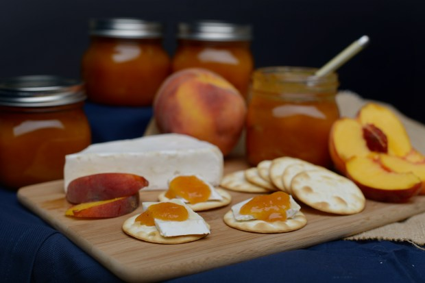 Spiced peach jam and Brie cheese layered on crackers