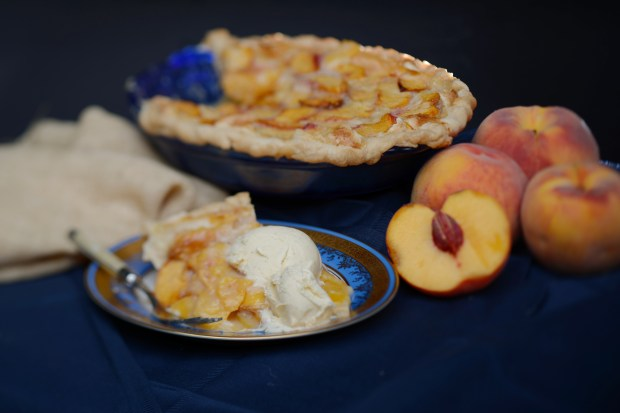 Peach Pie Supreme, from Creme de Colorado, topped with ice cream, shot on August 18, 2016 in Denver, Colorado. Palisade peaches from Colorado's Western Slope are typically in season from late July through September.