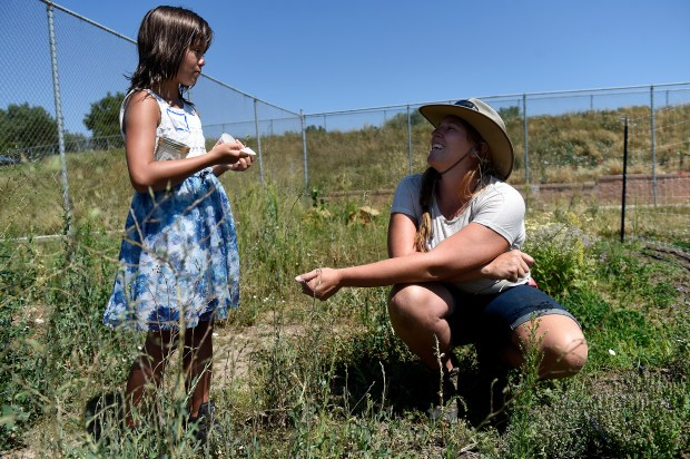 LAKEWOOD, CO - JULY 27: Hailey, left, tries different herbs as Katie Huszcza helps her find one she likes to put in her homemade butter in the community farm at Mountair Park in Lakewood, Colorado on July 27, 2016. Lakewood recently did a food asset survey through Hometown Colorado. It identified more food opportunities and where food could be grown in the city. (Photo by Seth McConnell/The Denver Post)