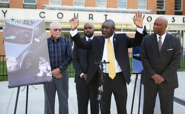 Attorney Benjamin Crump, center, one of the attorneys for Crutcher's family, says that Terence Crutcher's hands were up as he speaks during a news conference about the shooting death of Crutcher, Sept. 20, 2016 in Tulsa, Okla.