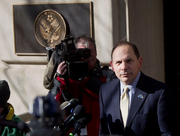 In this Feb. 24, 2015 file photo, Veteran Affairs Secretary Robert McDonald speaks to reporters outside VA Headquarters in Washington. More than one-third of calls to a suicide hotline for troubled veterans are not being answered by front-line staffers because of poor work habits and other problems at the Department of Veterans Affairs.