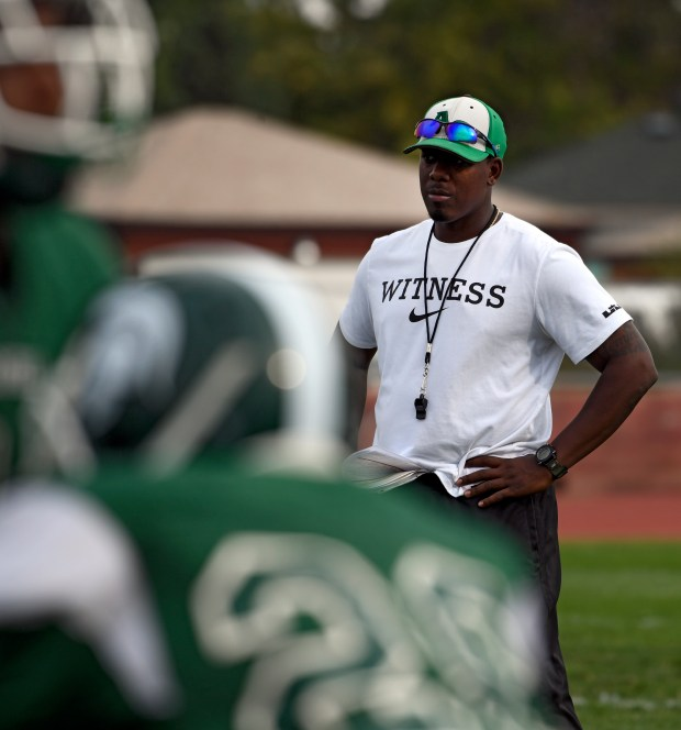 Jamarr Kerney of Aurora Central watches as his football team gets in practice