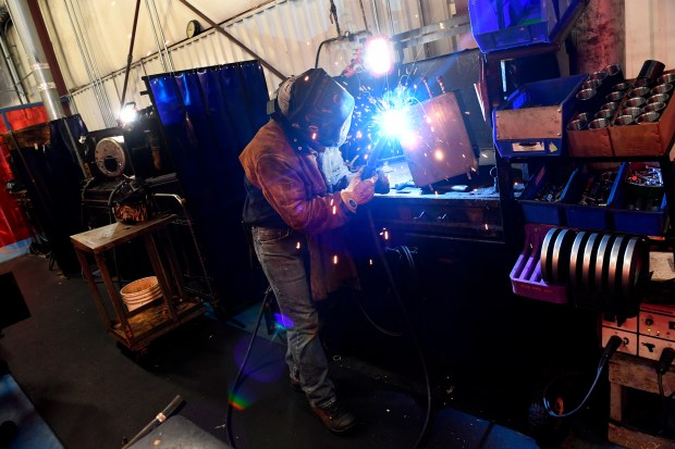 Justin Wright works on welding a tank of one of the heating systems on the production line at Aqua Hot Heating Systems on August 31, 2016 in Frederick.
