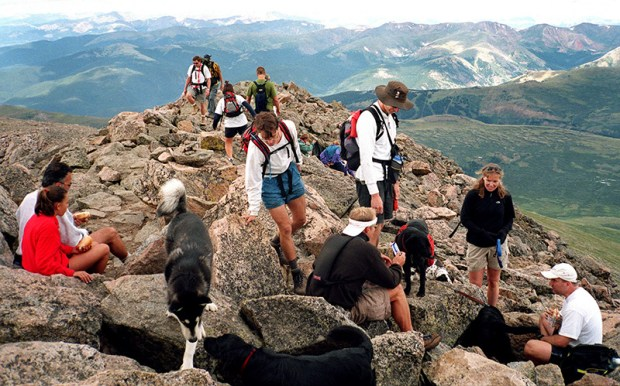 Hikers crowd the 14,060-foot summit of Mount Bierstadt.