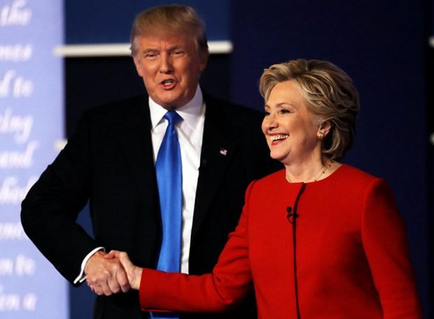 Republican presidential nominee Donald Trump shakes hands with Democratic presidential nominee Hillary Clinton following Monday's debate at Hofstra University in Hempstead, N.Y.